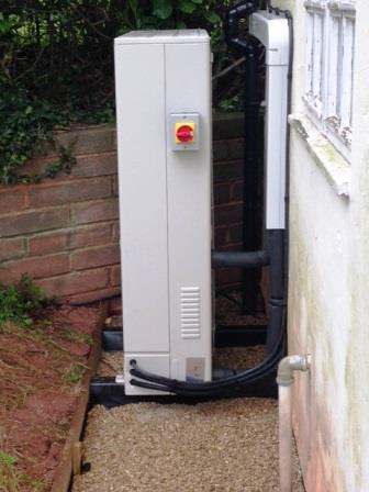 Mitsubishi 14kW Ecodan Air Source Heat Pump installed by GSM Limited at a Gorsley home. Smaller than an oil tank!