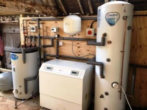 Picture showing internal heat pump unit and tank, awaiting refurbishment of the interior by the homeowner. GSM Limited are able to build bespoke housing units for those homes without the internal space.