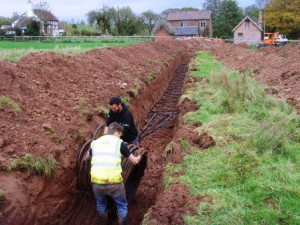 With the trenching complete , GSM go about laying the collector pipes for the Ground Source Heat Pump.